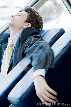 Tired young businessman