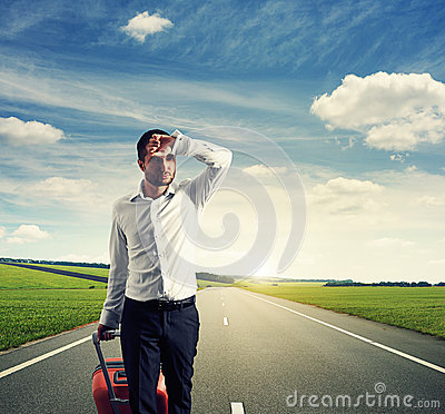 Free Tired Young Businessman With Suitcase Royalty Free Stock Photo - 33471205