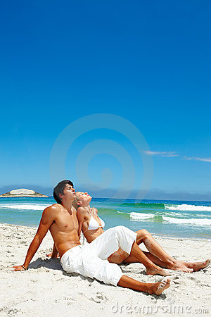A tired young couple resting on the beach