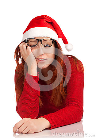 Tired young woman in santa hat