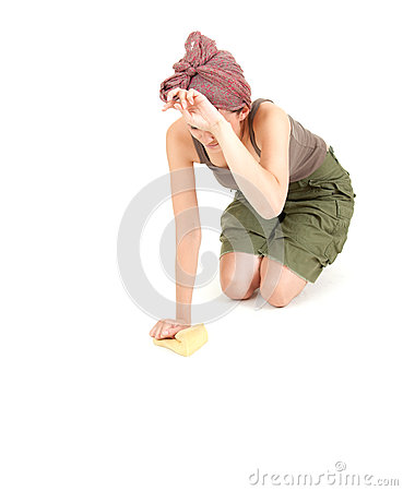 Tired young woman with sponge cleaning floor