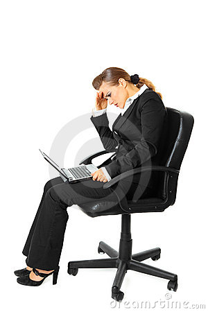 Tiredness business woman using laptop