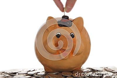 Tirelire sur des pièces de monnaie