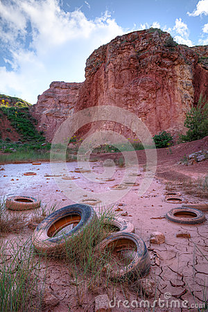 Tires In A Bauxite Pit Royalty Free Stock Photo - Image: 24750555