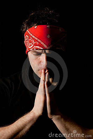 Tmotional portrait of a young praying man