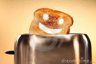 Toast with smiley face in toaster