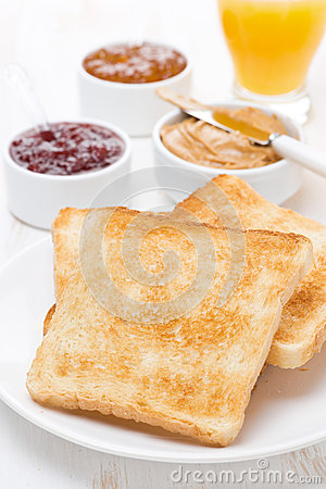 toast with various jams and peanut butter, orange juice