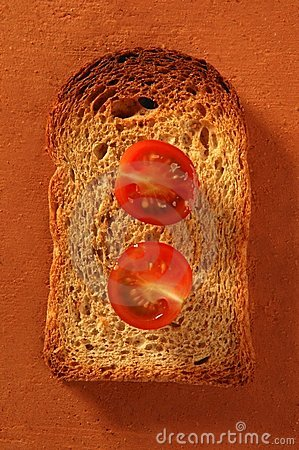 Toasted bread slices and cherry tomatoes