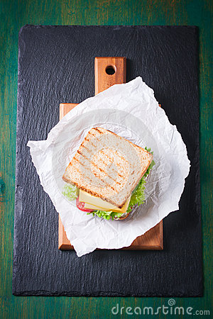 Free Toasted Sandwich With Salad Leaves, Tomatoes And Cheese With Fork On A Cutting Board Stock Photos - 71614023