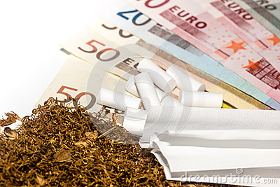 Tobacco Carbon Filters Paper Against The Background Of Money Stock Photo Image 34994680
