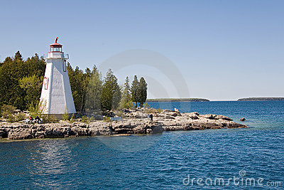 Tobermory view from boat to island and lighthouse