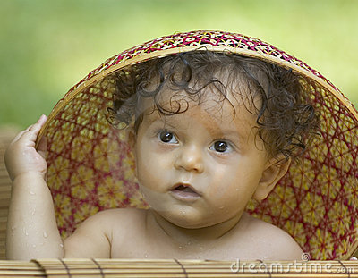 Toddler in an asian hat