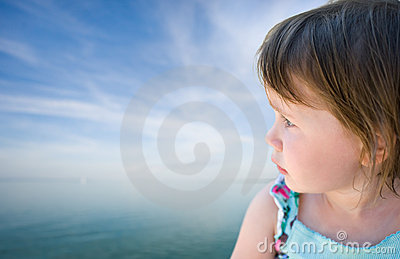 Toddler baby girl staring into the horizon.