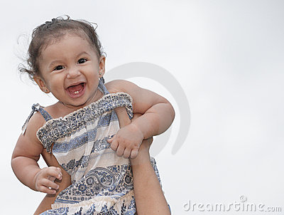Toddler being held in the air