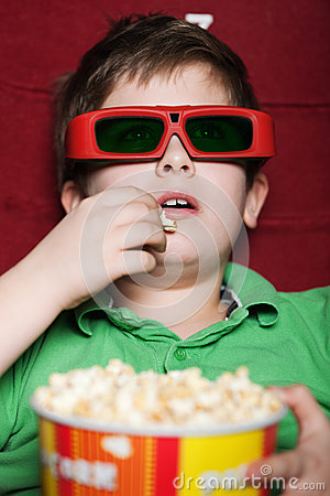 Toddler boy in 3D movie theater