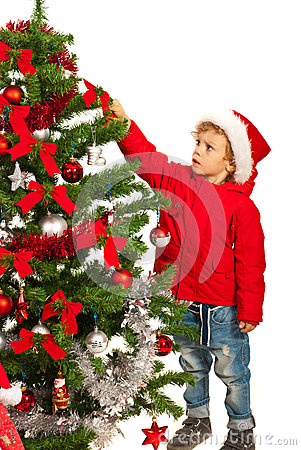 Toddler boy decorate tree