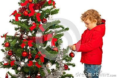 Toddler boy decorate Xmas tree