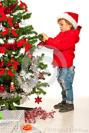 Toddler boy decorate Xmas tree