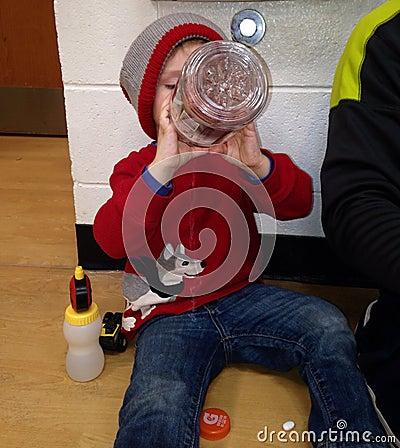Toddler Boy drinking Gatorade Editorial Stock Photo