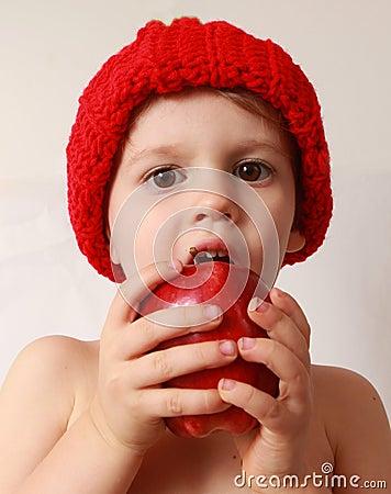 Toddler boy eating an apple