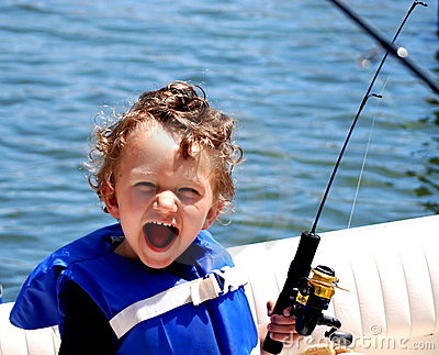 Toddler Boy fishing on a boat