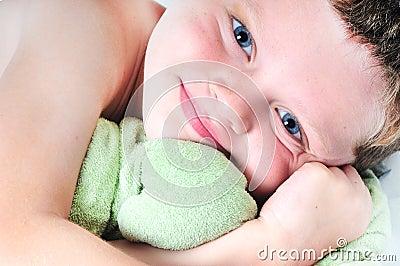 Toddler boy hugging toy