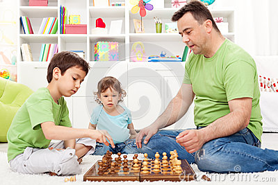Toddler boy looking at chess game