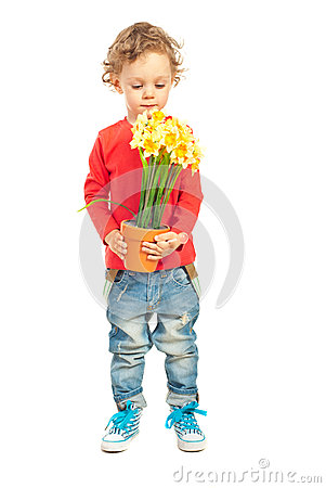 Free Toddler Boy Smelling Flowers Stock Photography - 30791232
