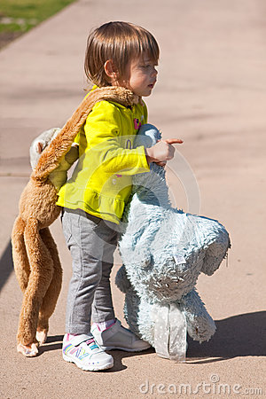 Toddler carrying stuffed animals