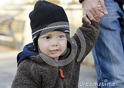 Toddler child holding hand