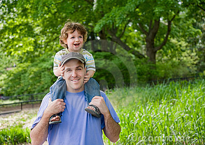 Toddler on Dad s shoulders.