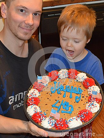 Toddler and Daddy with giant Independence Day Cookie