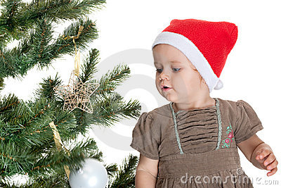 Toddler is decorating a christmas tree