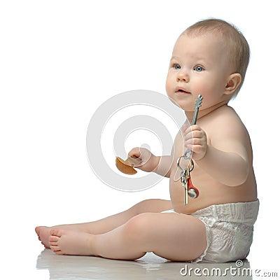 Toddler in diaper playing