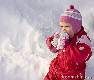 Toddler eating snow
