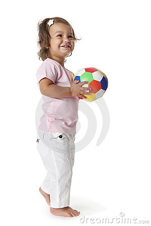 Toddler girl with a colored ball