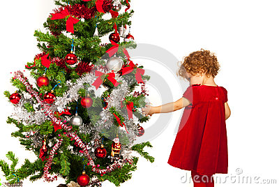 Toddler girl decorate Xmas tree