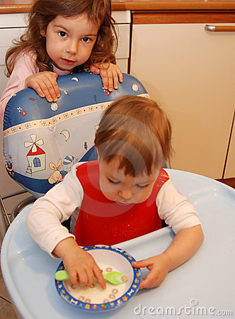 Free Toddler Girl Eating Cereal Stock Image - 4888911