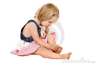 Toddler girl examines her toes
