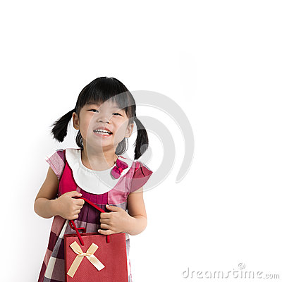 Toddler girl with gift bag