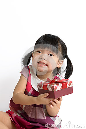Toddler girl with gift box