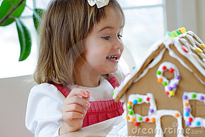 Toddler girl with gingerbread cookie