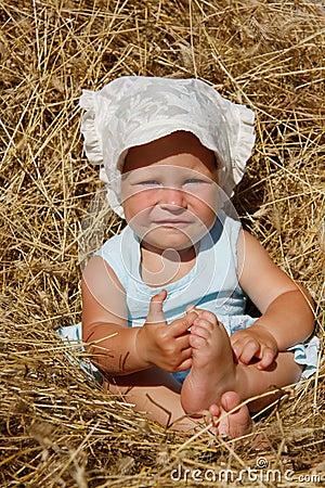 Toddler girl in hay