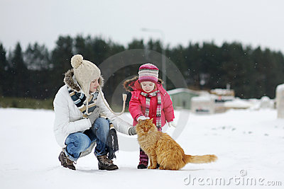 Toddler girl and her mother on a winter day