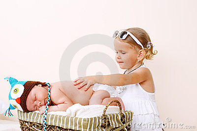 Toddler girl and newborn baby