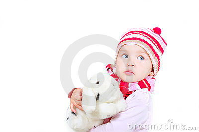 Toddler girl with toy rabbit