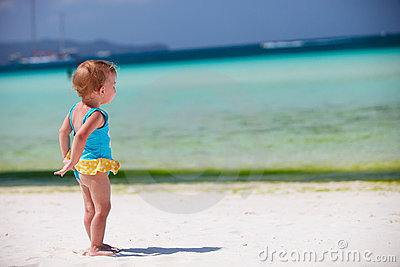 Toddler girl at tropical beach