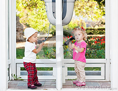Toddler girls  with city phone