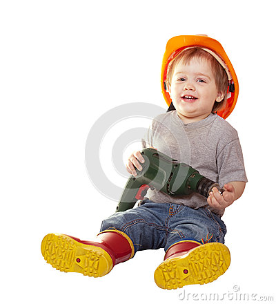 Toddler in hardhat with drill. Isolated over white