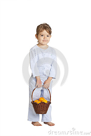 Toddler holding basket of oranges, clipping path